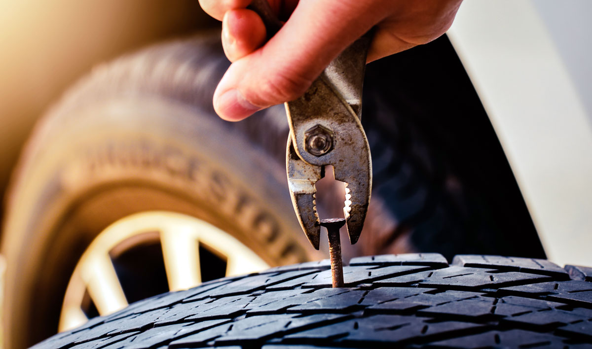 Read more about the article Does Car Insurance Cover a Nail In the Tire?