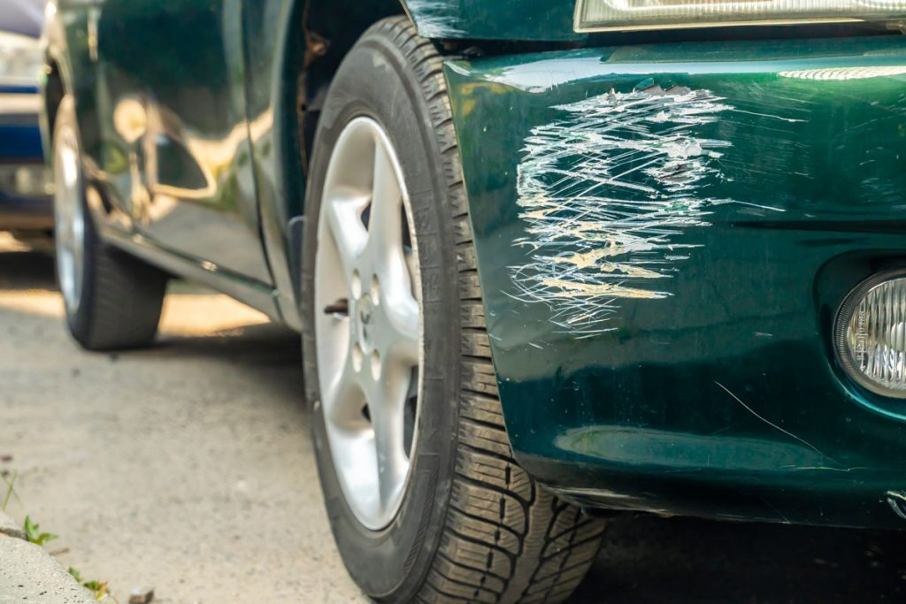 Front car scratches due to car accident