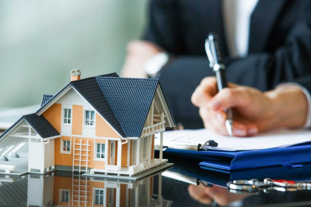 House insurances agent signing important papers
