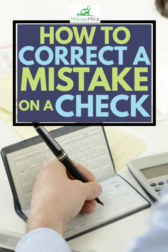 Businessman writing details on a check, How to Correct a Mistake on a Check