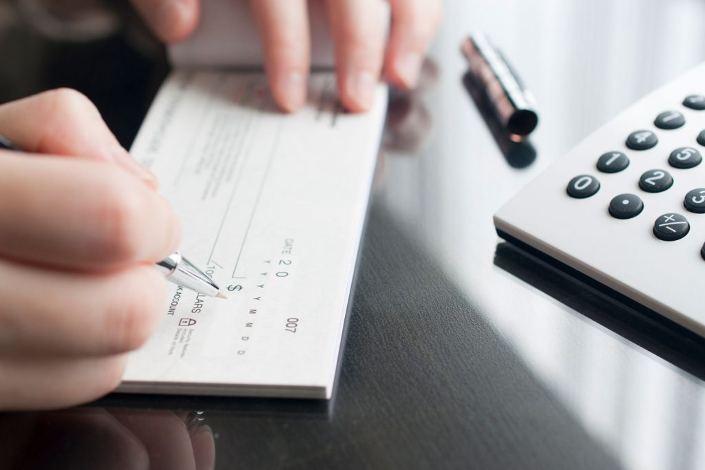 Business woman preparing to write a check