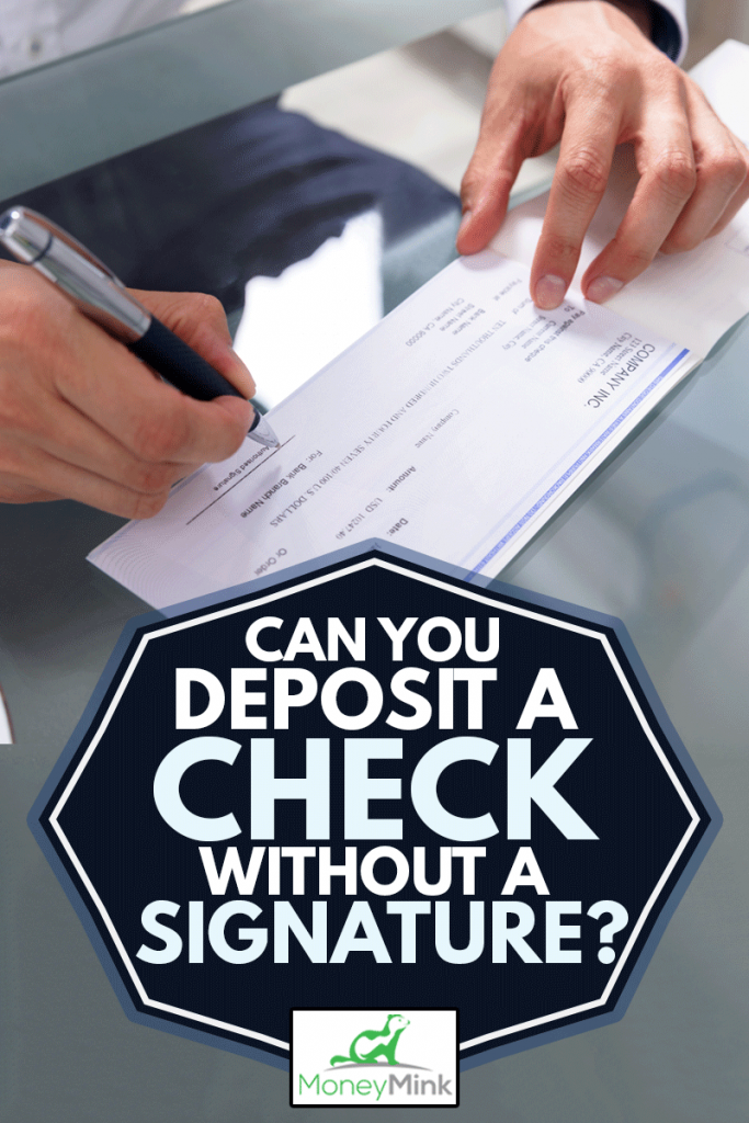 Businessman's Hand Signing Check On Glass Desk, Can You Deposit A Check Without A Signature?