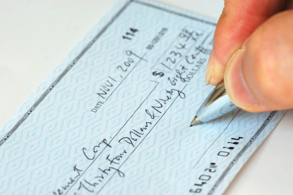Writing a check for bill payment