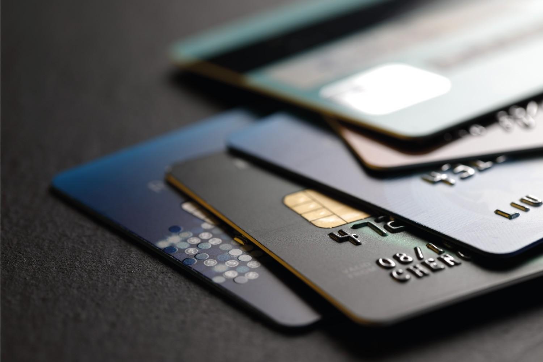 Stack of credit cards on black background